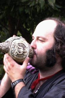 Johnathon blows the 300 year old Tibetan Conch...the 'dung-dkar'